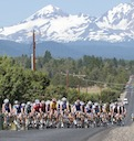 Peloton leaving Bend, Oregon against Cascade Mountains backdrop