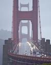 Liquid sunshine bathes the Golden Gate Bridge as the pelton parades across