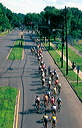 A Stretched out peloton heads back into downtown Trenton